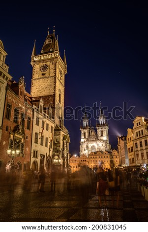 Night time illuminations of the the Old Town Hall, Town Square and  Church of our Lady before Tyn in background. Prague,Czech Republic. - stock photo