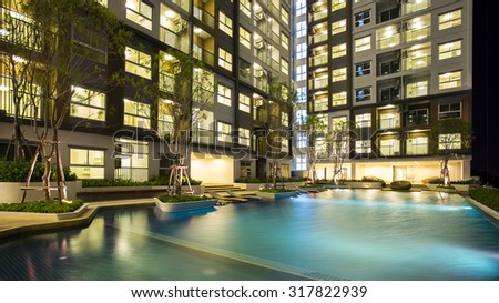 night time of condominium and swiming pool life of City people in modern town - stock photo
