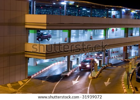 Night Time Parking at the Airport Parking Garage - stock photo