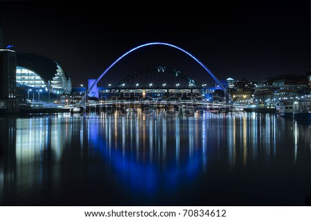 Night-time photograph of the bridges over the River Tyne in Newcastle upon Tyne/Gateshead. - stock photo