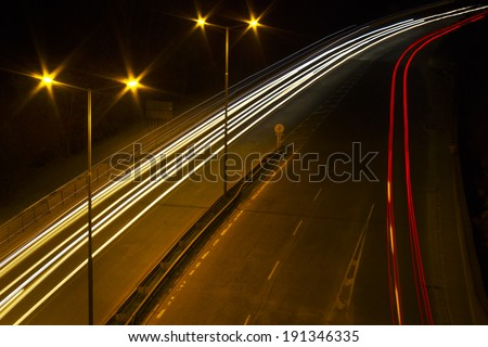 Night time shot of speeding traffic - stock photo
