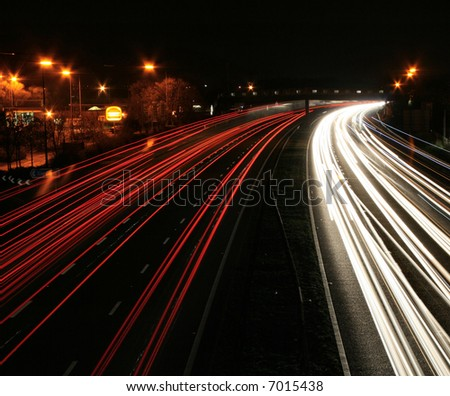 night time traffic motion-blur service station - stock photo