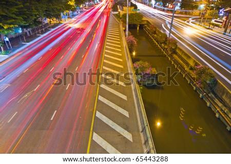 night time traffic motion, long trail light - stock photo