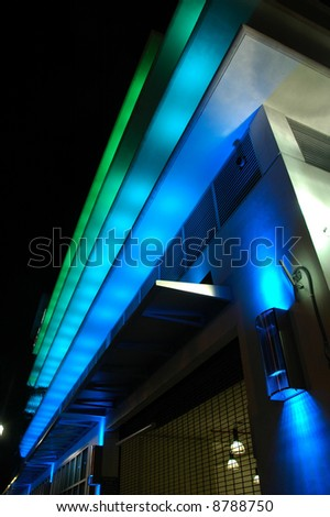 Night Time view of Colorfully Lighted Fashion Store in South Beach, Florida