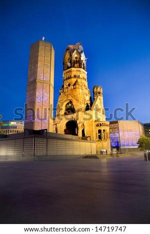 Night time view of illuminated Kaiser-Wilhelm Memorial Church in Berlin - stock photo