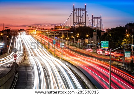 Night traffic an light trails on I-278 near RFK (aka Triboro) bridge in New York City - stock photo