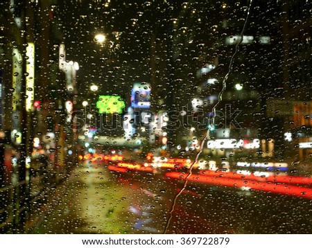 Night traffic and rain in central Tokyo's business district.