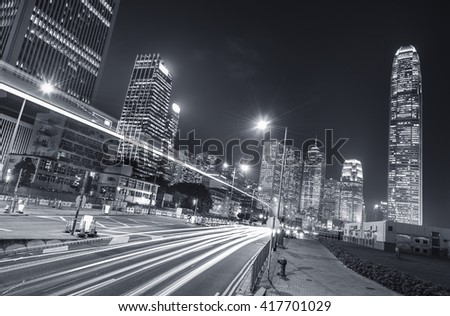 Night traffic and skyline of Hong Kong city - stock photo