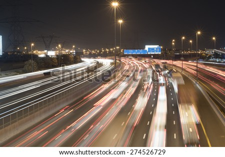 Night traffic at Dubai - stock photo
