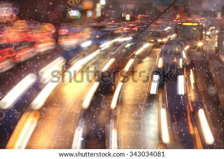 Night traffic car road blur light snow - stock photo