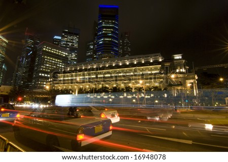 Night traffic in singapore with blur motions and high rise buildings - stock photo
