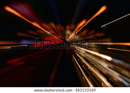 Night traffic in the city, car lights in motion blur with zoom effect - stock photo