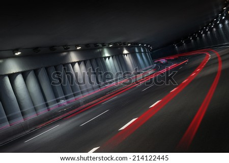 Night traffic in tunnel, long exposure - stock photo