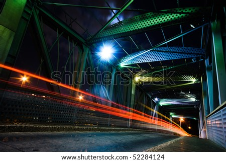Night traffic on  a suspension bridge - stock photo