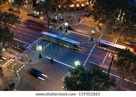 night traffic on an avenue in Barcelona, Spain - stock photo