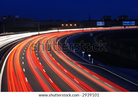 night traffic on autobahn to munich, germany - stock photo