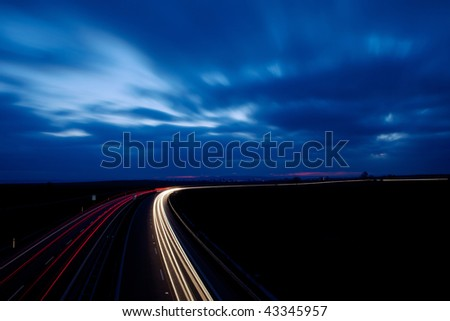 Night traffic rush on a highway in the UK - stock photo