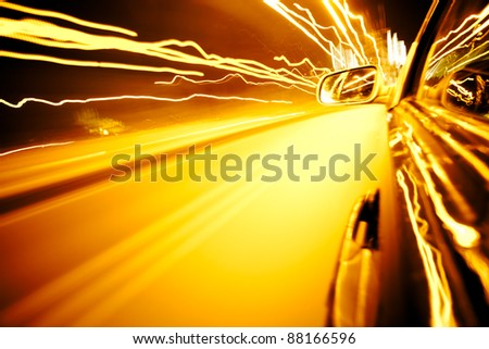 Night traffic,shoot from the window of rush car,motion blur steet light. - stock photo