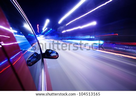 Night traffic,shoot from the window of rush car,motion blur street light. - stock photo