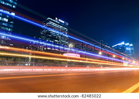 night traffic with modern building background in beijing,China - stock photo