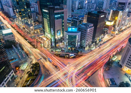Night traffic zips through an intersection in the Gangnam district of Seoul, South Korea.