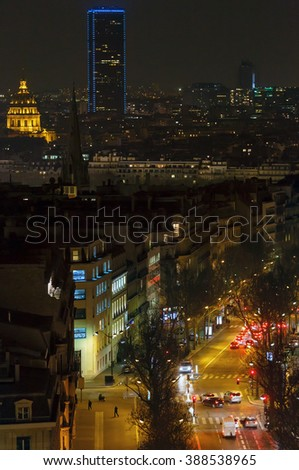 Night urban view from Triumphal Arch and Tour Montparnasse, Paris, France. All people are unrecognizable. - stock photo