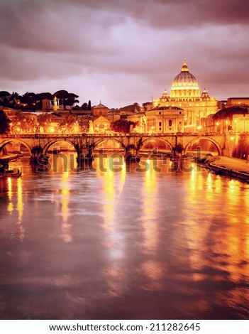Night view at St. Peter's cathedral in Vatican, Rome, Italy, beautiful reflection of illuminated catholic church, summer travel and tourism concept