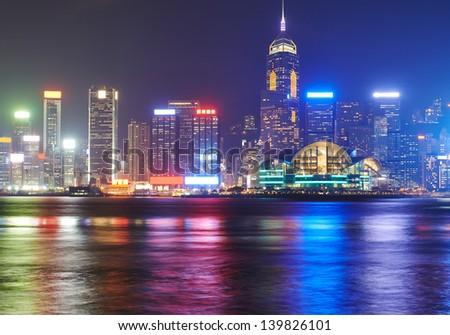night view at the Hong Kong island with reflections at victoria harbor - stock photo