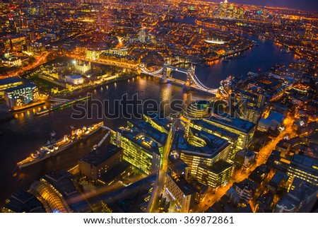 Night view City of London. Lit up buildings and streets aerial view - stock photo