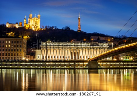 night view from Lyon city near the Fourviere cathedral and Seine river - stock photo