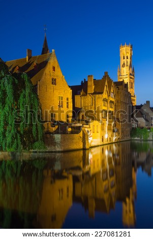Night view from the Rozenhoedkaai of the Old Town of Bruges (Bruges, Belgium). Vertically. - stock photo