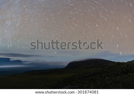 Night view from Uei tepuy, with star trails, in Venezuela - stock photo