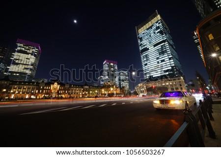 https://thumb7.shutterstock.com/display_pic_with_logo/167494286/1056503267/stock-photo-night-view-in-tokyo-1056503267.jpg
