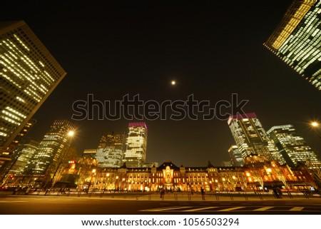 https://thumb7.shutterstock.com/display_pic_with_logo/167494286/1056503294/stock-photo-night-view-in-tokyo-1056503294.jpg