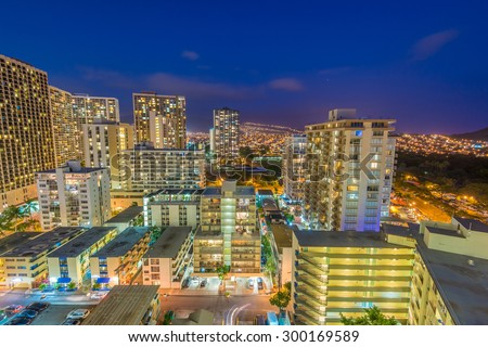 Night view nature and cityscape concept: evening outdoor urban view of modern real estate city in Honoluu, Hawaii. - stock photo