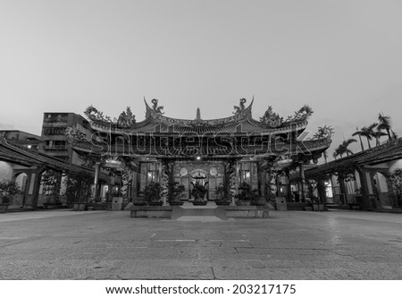 night view of a Chinese temple in black and white - stock photo