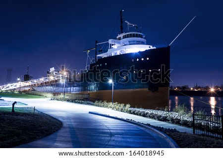 Night view of a lake freighter ship docked at the port of Toledo Ohio.  - stock photo