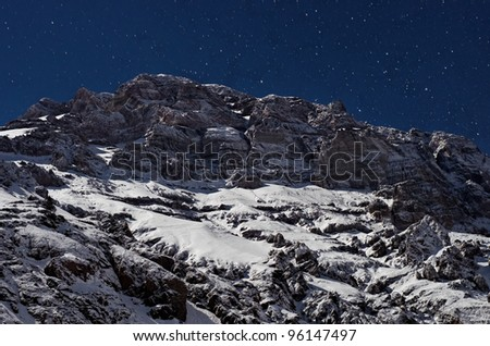Night view of Aconcagua from Plaza de Mulas base camp. Aconcagua Provincial Park, Mendoza, Argentina, South America. Aconcagua is the highest mountain in America. - stock photo