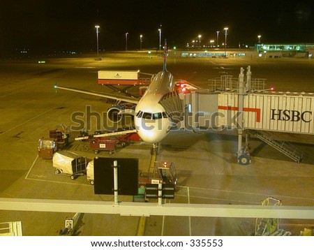 night view of an Airbus A320 airplane being readied for Boarding at London-Stansted - stock photo