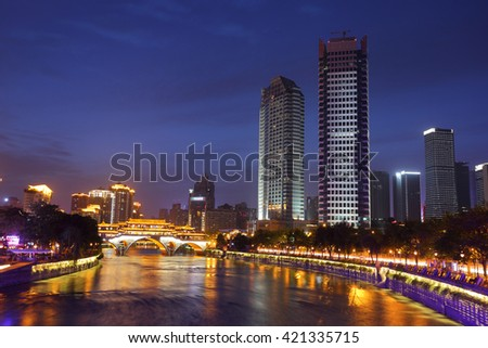 Night view of beautiful Anshun Bridge above Jinjiang river, and downtown of Jiuyanqiao in the blue hour, Chengdu, Sichuan, China