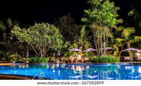 night view of beautiful swimming pool in tropical resort , Koh Chang Thailand - stock photo