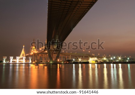 Night view of Bhumibol Bridge in Thailand, also known as the Industrial Ring Road Bridge. The bridge crosses the Chao Phraya River. - stock photo