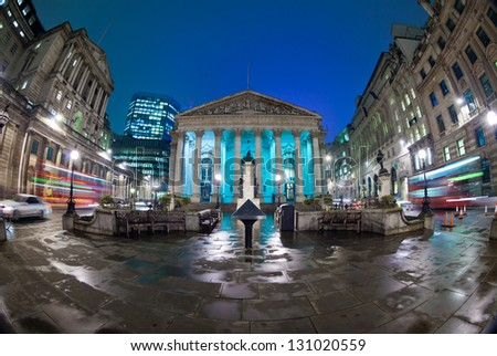 Night view of British financial heart, Bank of England and Royal Exchange. The photo was taken at a slow shutter speed wide-angle fisheye lens - stock photo