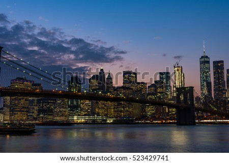 Night view of Brooklyn bridge and Skyscrapers in New York