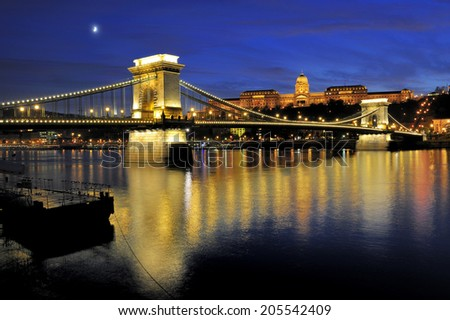 Night view of Chain Bridge, Royal Palace and Danube river, Budapest, Hungary  - stock photo