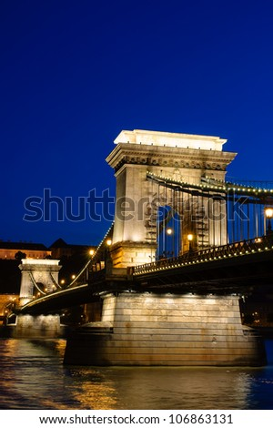 Night view of Chain bridge, Royal Palace and Danube river in Budapest - stock photo