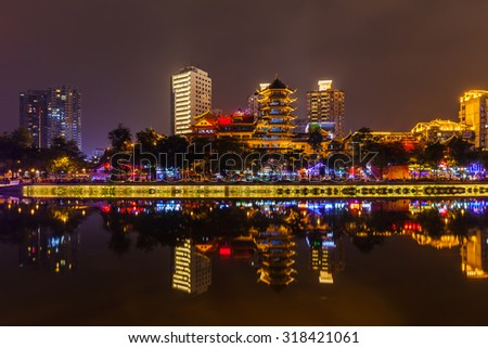 Night view of Chengdu cityscape on the Jin river side with beautiful illumination and reflection of buildings in the water, Sichuan province, China - stock photo