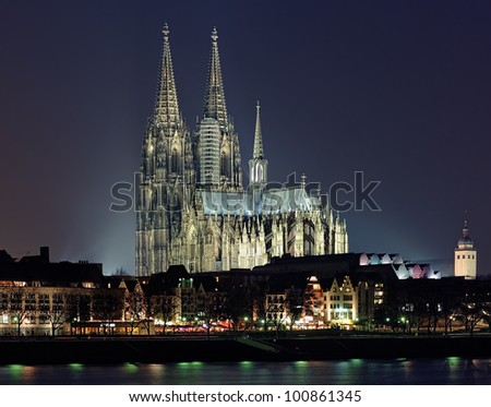 Night view of Cologne Cathedral from the Rhine river, Germany - stock photo