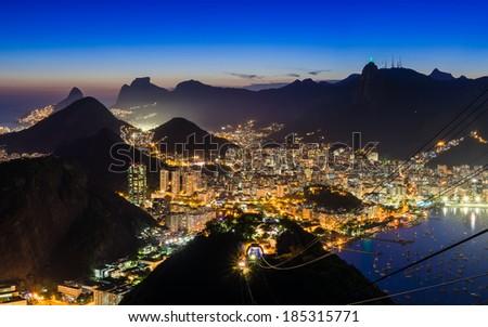 Night view of Corcovado and Botafogo in Rio de Janeiro. Brazil - stock photo