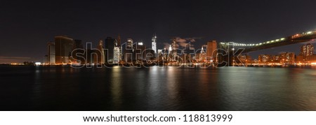 Night view of downtown Manhattan from the southern tip to the Brooklyn Bridge following Hurricane Sandy and power outage as of November 3, 2012. Some buildings have power returned to them. - stock photo